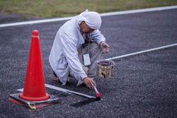 Track worker marks the track