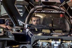 A mechanic in the Ligier JS P217