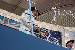 Lewis Hamilton, Mercedes AMG F1 celebrates on the podium with the champagne with Daniel Ricciardo, R