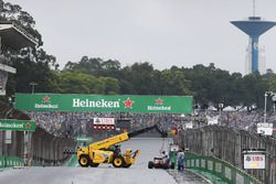 The Ferrari SF16-H of Kimi Raikkonen, Ferrari is removed from the circuit after he crashed out of th