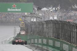 The crashed car of Kimi Raikkonen, Ferrari SF16-H, causes a stoppage