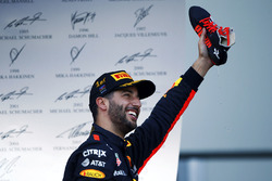 Daniel Ricciardo, Red Bull Racing, celebrates his victory on the podium, champagne in his shoe