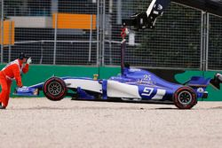 Marshals remove the beached car of Marcus Ericsson, Sauber C36