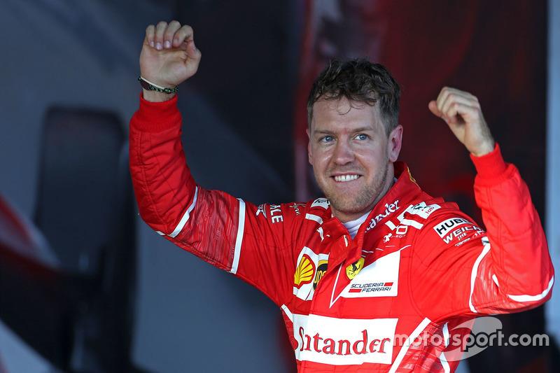 El ganador Sebastian Vettel, Ferrari