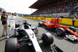 Pole winner Lewis Hamilton, Mercedes AMG F1, celebrates alongside Sebastian Vettel, Ferrari