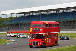 A Routemaster bus with guests on-track during practice