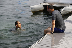 Reporter Tom Clarkson and Matt Morris, Engineering Director, McLaren, take a dip in the Saint Lawrence River