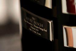 The name of Kurt Busch, Stewart-Haas Racing Ford on the Daytona 500 trophy