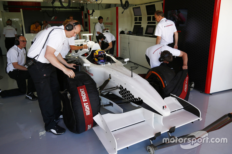 The F1 Experience car is prepared by mechanics