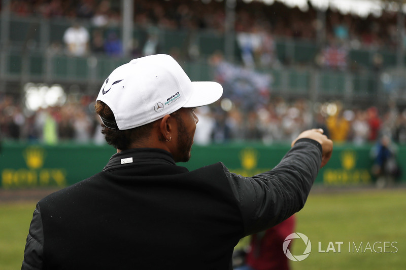 Lewis Hamilton, Mercedes AMG F1, points to fans in a grandstand