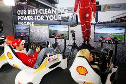Sebastian Vettel, Ferrari, plays a computer game