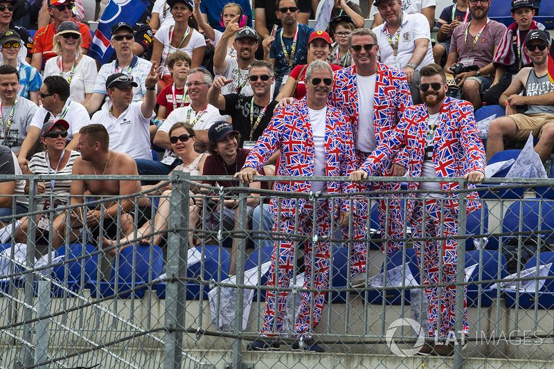 Fans in Union flag suits