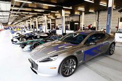 An Aston Martin next to a Jaguar Formula E