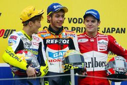 Podium: winner Valentino Rossi, Repsol Honda Team, second place Akira Ryo, Suzuki, third place Carlos Checa, Yamaha Factory Racing