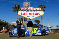 Jimmie Johnson, Hendrick Motorsports Chevrolet and crew chief Chad Knaus in front of the Welcome to Fabulous Las Vegas sign