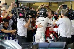 Second place and new world champion Nico Rosberg, Mercedes AMG F1 and Sebastian Vettel, Scuderia Ferrari