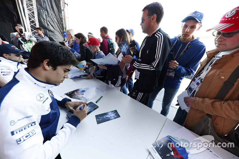Lance Stroll, Williams, signs autographs for fans, alongside Felipe Massa, Williams
