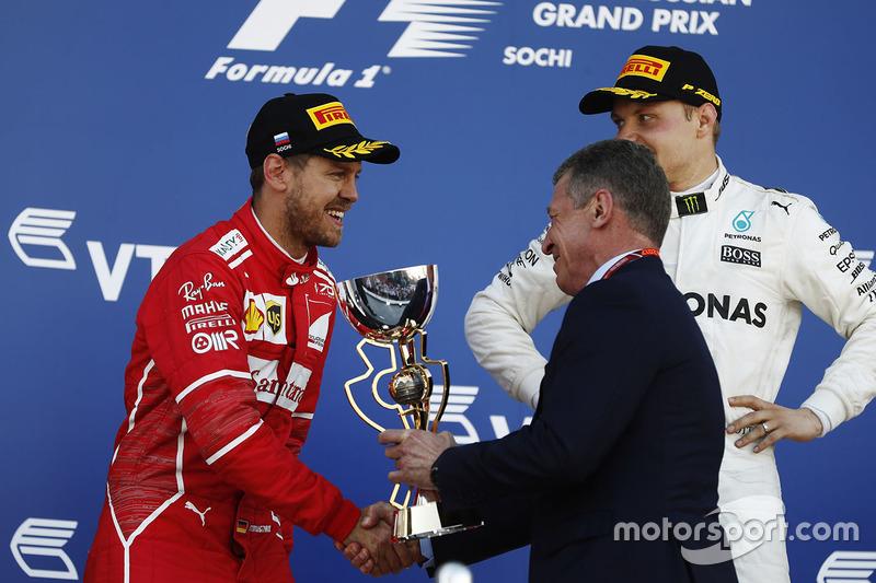 Dmitry Kozak, Deputy Prime Minister of the Russian Federation presents the second place trophy to Sebastian Vettel, Ferrari
