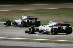 Felipe Massa, Williams FW40, passes the stopped car of team mate Lance Stroll, Williams FW40
