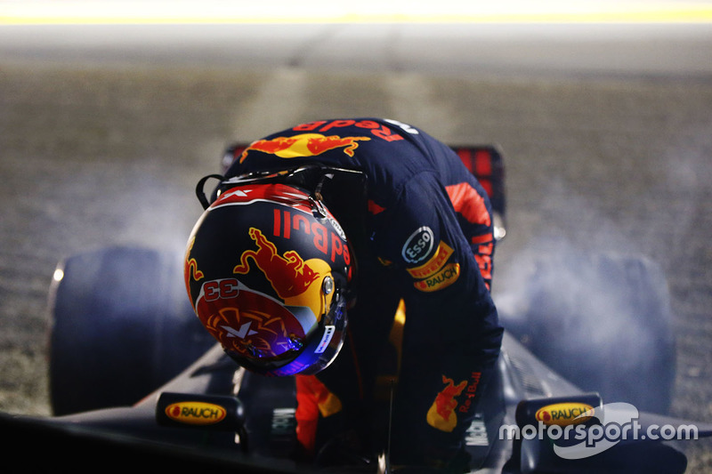Max Verstappen, Red Bull Racing RB13, climbs from his car after retiring from the race