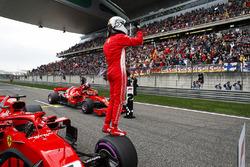 Sebastian Vettel, Ferrari, celebrates pole as team mate and front row starter Kimi Raikkonen, Ferrari, climbs out of his car