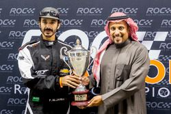 Fala Aljarba is presented with a trophy by Prince Khaled Al Faisal, President of the Motor Federatio