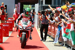 Third place Eugene Laverty, Milwaukee Aprilia rides into parc ferme