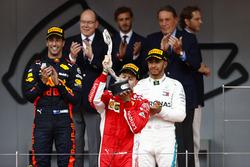 Sebastian Vettel, Ferrari SF71H, kisses his second place trophy on the podium