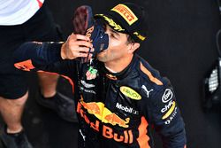 Race winner Daniel Ricciardo, Red Bull Racing celebrates with a shoey on the podium