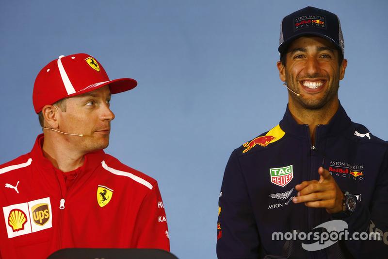 Kimi Raikkonen, Ferrari, and Daniel Ricciardo, Red Bull Racing, share a joke in the Thursday press conference