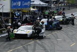 #63 Scuderia Corsa Ferrari 488 GT3, GTD: Cooper MacNeil, Gunnar Jeannette, #14 3GT Racing Lexus RCF GT3, GTD: Dominik Baumann, Kyle Marcelli, #44 Magnus Racing Audi R8 LMS GT3, GTD: John Potter, Andy Lally pit stops.