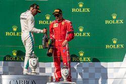 Lewis Hamilton, Mercedes-AMG F1 and Kimi Raikkonen, Ferrari celebrate on the podium with the champagne