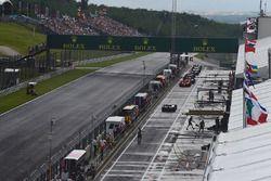 Cars queue in pit lane