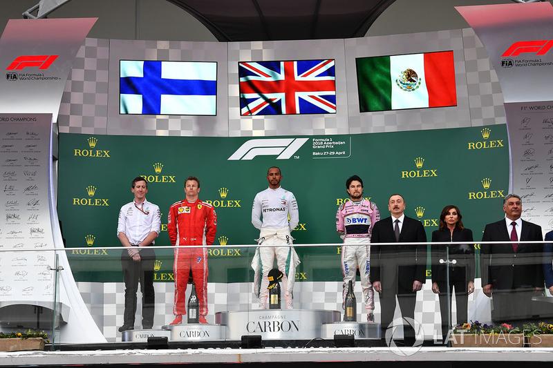 Kimi Raikkonen, Ferrari, Lewis Hamilton, Mercedes-AMG F1 and Sergio Perez, Force India on the podium