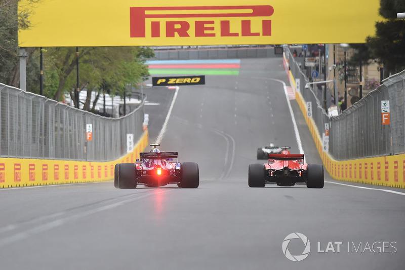 Sebastian Vettel, Ferrari SF71H y Pierre Gasly, Scuderia Toro Rosso STR13