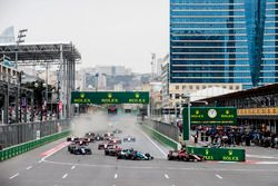 George Russell, ART Grand Prix, leads Alexander Albon, at the start of the race