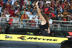A Toyota Landcruiser on two wheels, grid girl