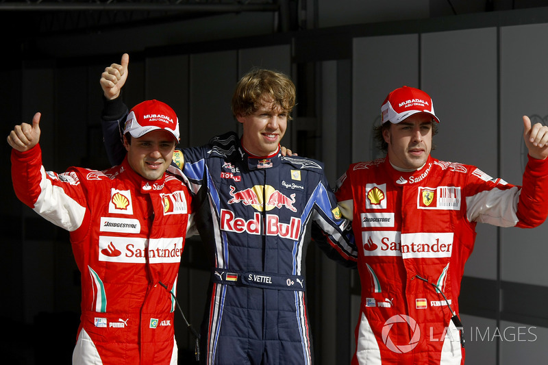 Sebastian Vettel, Red Bull Racing RB6 Renault celebrates with Felipe Massa, Ferrari F10 and Fernando Alonso, Ferrari F10 after taking Pole Position