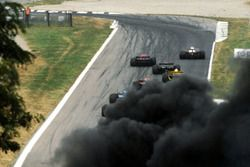 As the front runners make it to the Rettifilo chicane at the start of the race, a thick black plume of smoke obscures the circuit as a multi-car accident decimates much of the field