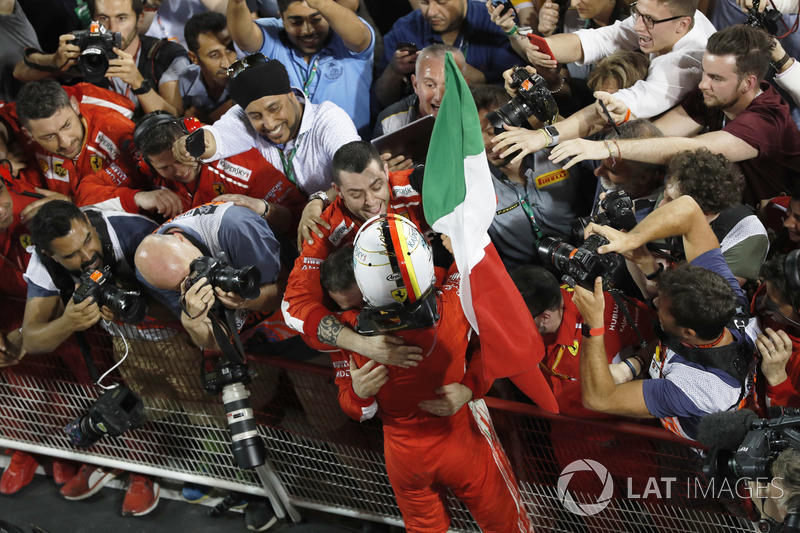 Sebastian Vettel, Ferrari, 1st position, celebrates victory on arrival in Parc Ferme with his team