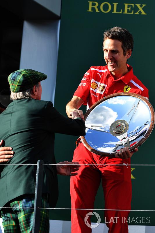Inaki Rueda, Ferrari Race Strategist celebrates with the trophy on the podium