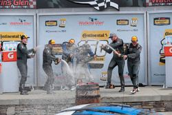 Podium: race winners Cameron Cassels, Trent Hindman, Bodymotion Racing, second place Tyler McQuarrie, Tilt Bechtolscheimer, CJ Wilson Racing, third place Daniel Burkett, Marc Miller, CJ Wilson Racing are celebrating with champagne