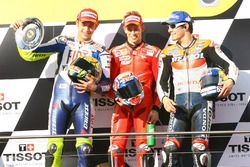 Podium: second place Valentino Rossi, Yamaha; Race winner Casey Stoner, Ducati; third place Nicky Hayden, Repsol Honda