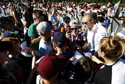 Valtteri Bottas, Williams Martini Racing, signs autographs for fans