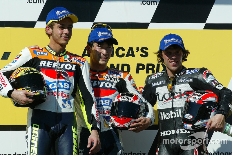 Podium: Sieger Tohru Ukawa, 2. Platz Valentino Rossi, 3. Platz Loris Capirossi