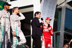 Podium: winner Nico Rosberg, Mercedes AMG F1 Team, second place Lewis Hamilton, Mercedes AMG F1 Team, third place Sebastian Vettel, Ferrari with Mark Webber, Porsche Team WEC Driver and Channel 4 Presenter