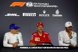 Conferenza stampa: il vincitore della gara Sebastian Vettel, Ferrari, il secondo classificato Valtteri Bottas, Mercedes-AMG F1, il terzo classificato Lewis Hamilton, Mercedes AMG F1