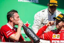 Giuseppe Vietina, Race Operations Manager, Ferrari, drinks from the Champagne bottle of Race winner Sebastian Vettel, Ferrari, on the podium