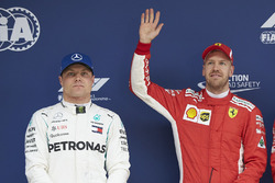 Valtteri Bottas, Mercedes AMG F1, alongside pole starter Sebastian Vettel, Ferrari