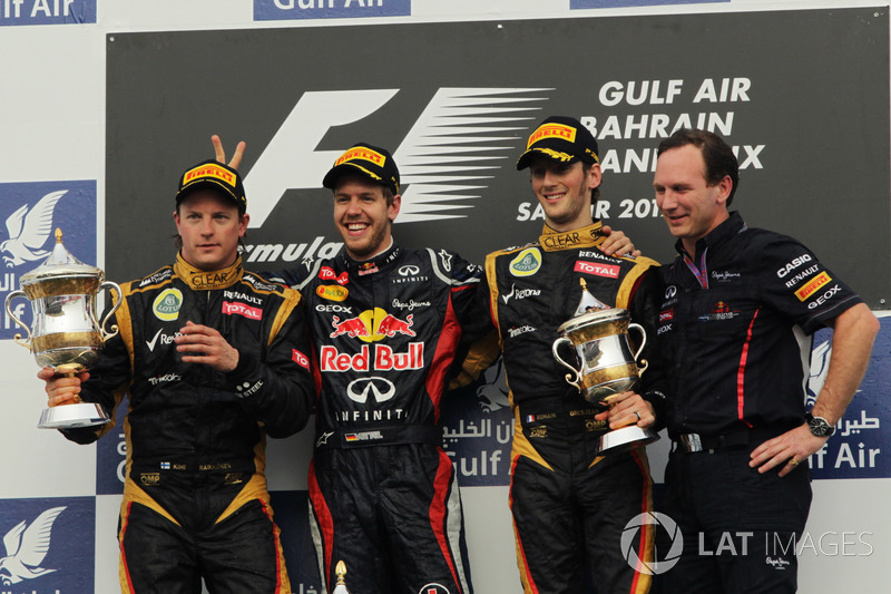 Podium: second place Kimi Raikkonen, Lotus F1 Team, Race winner Sebastian Vettel, Red Bull Racing, R